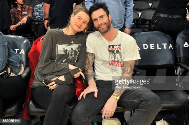 Singer Adam Levine and model Behati Prinsloo attend a basketball game between the Los Angeles Lakers and the Houston Rockets at Staples Center on...