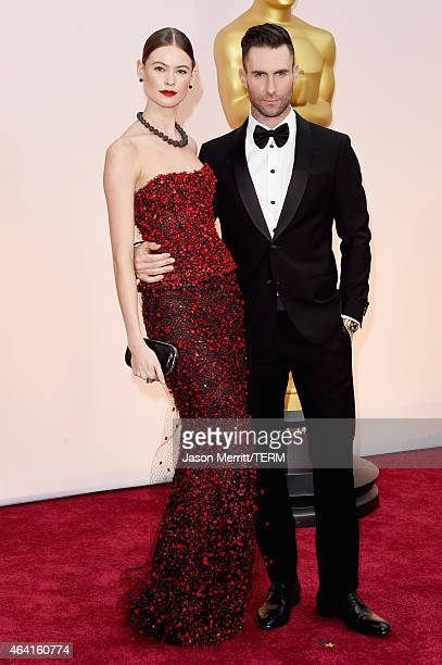 Singer Adam Levine and model Behati Prinsloo attend the 87th Annual Academy Awards at Hollywood & Highland Center on February 22, 2015 in Hollywood,...