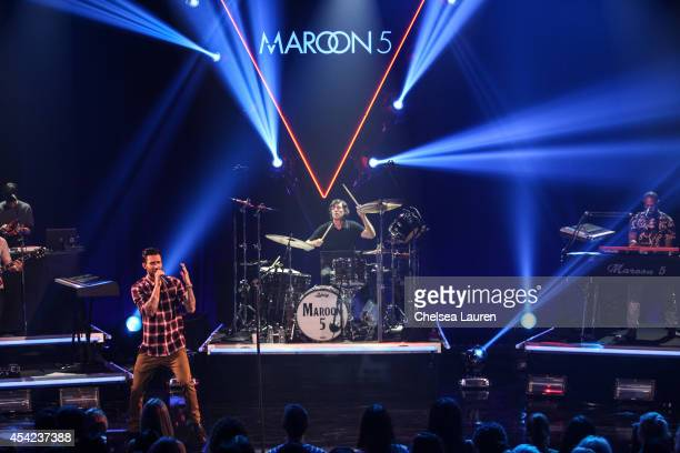 Singer Adam Levine and musician Matt Flynn perform onstage during the iHeartRadio Album Release Party with Maroon 5 for their album V at iHeartRadio...