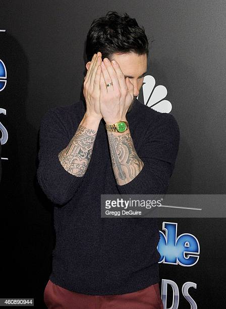 Singer Adam Levine arrives at The PEOPLE Magazine Awards at The Beverly Hilton Hotel on December 18 2014 in Beverly Hills California