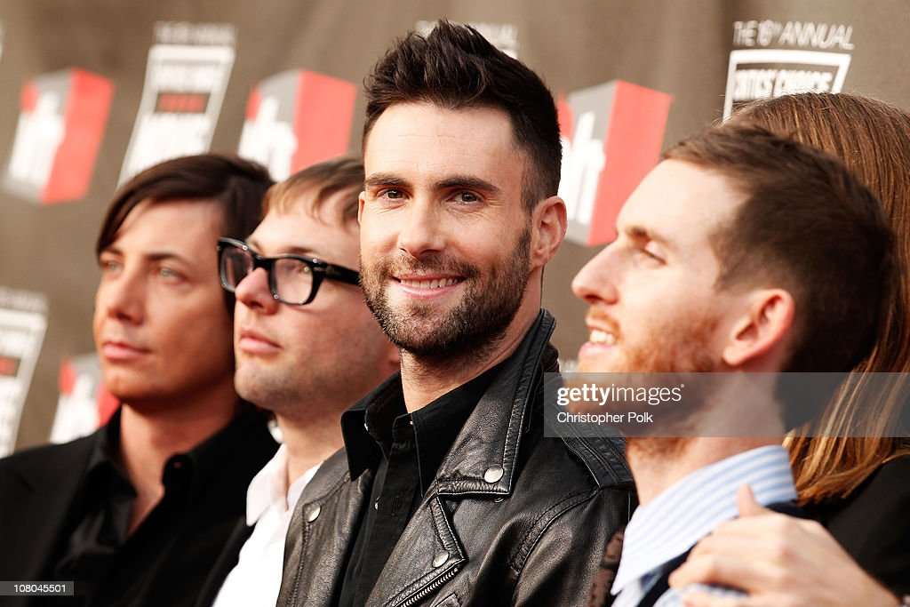 Singer Adam Levine (C) from the musical group Maroon 5 arrives at the 16th annual Critics' Choice Movie Awards at the Hollywood Palladium on January 14, 2011 in Los Angeles, California.
