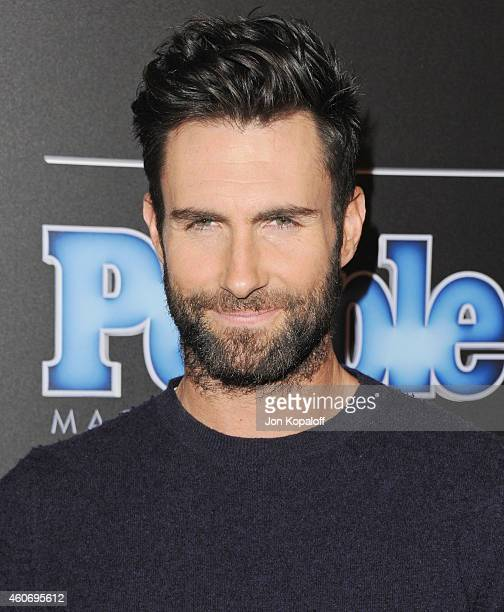 Singer Adam Levine of Maroon 5 arrives at The PEOPLE Magazine Awards at The Beverly Hilton Hotel on December 18 2014 in Beverly Hills California