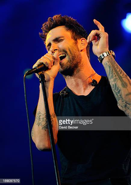 Singer Adam Levine of Maroon 5 performs during a keynote address at the 2013 International CES at The Venetian on January 7 2013 in Las Vegas Nevada...