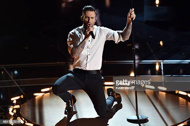 Singer Adam Levine of Maroon 5 performs 'Lost Stars' from 'Begin Again' onstage during the 87th Annual Academy Awards at Dolby Theatre on February 22...