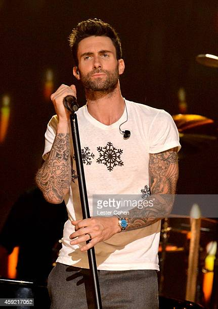 Singer Adam Levine of Maroon 5 performs onstage during A VERY GRAMMY CHRISTMAS at The Shrine Auditorium on November 18 2014 in Los Angeles California