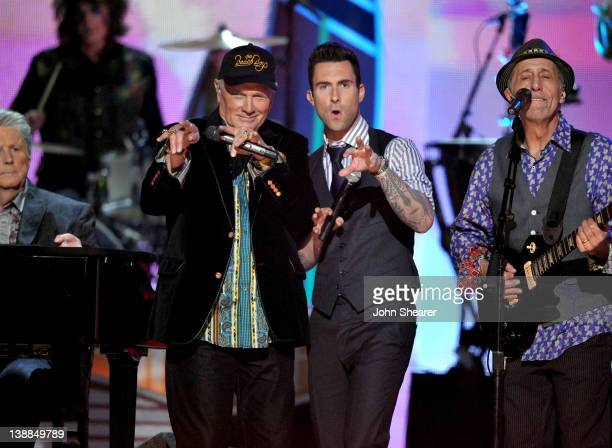 Singer Adam Levine of Maroon 5 performs with Brian Wilson Mike Love and David Marks of the Beach Boys onstage at The 54th Annual GRAMMY Awards at...