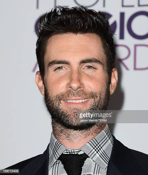 Singer Adam Levine of Maroon 5 poses in the press room with the Favorite Band award at the 39th Annual People's Choice Awards at Nokia Theatre LA...