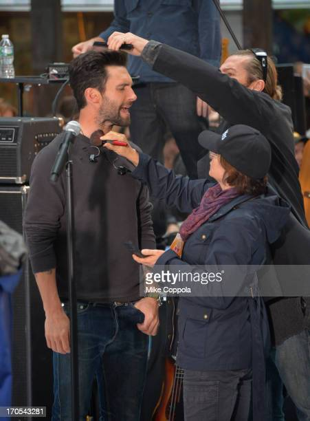 Singer Adam Levine of the band Maroon 5 performs has his hair and makeup adjusted prior to performing on NBC's Today at the NBC's TODAY Show on June...