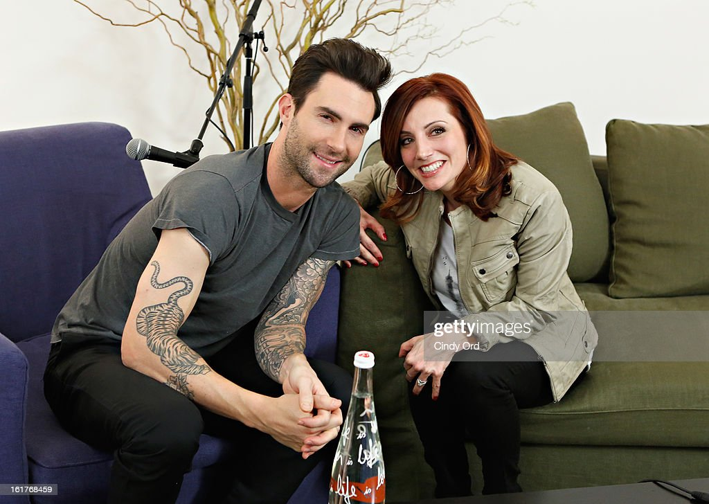 Singer Adam Levine (L) poses with radio personality Danielle Monaro (R) of 'Elvis Duran and the Morning Show' at The Mercer Hotel on February 15, 2013 in New York City.