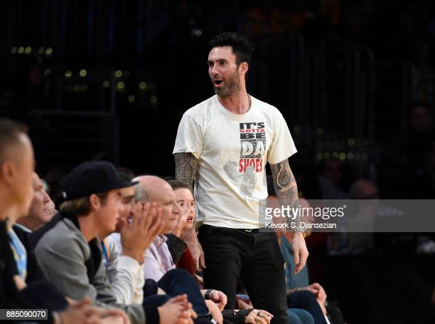 Singer Adam Levine reacts to a three point basket by James Harden of the Houston Rockets during the second half against Los Angeles Lakers as he...