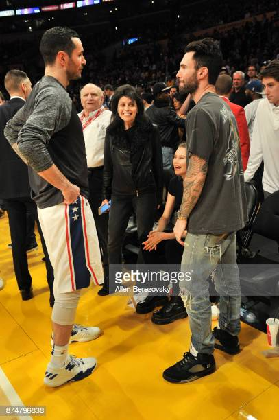 Singer Adam Levine talks to JJ Redick at a basketball game between the Los Angeles Lakers and the Philadelphia 76ers at Staples Center on November 15...