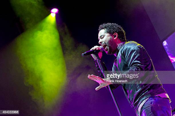 Singer Adel Tawil performs live during a concert at the Kindlbuehne Wuhlheide on August 23 2014 in Berlin Germany