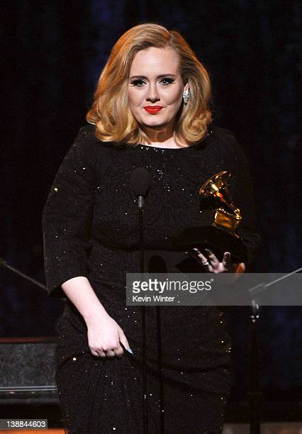 "Singer Adele accepts the Best Pop Solo Performance Aweard for ""Someone Like You"" onstage at the 54th Annual GRAMMY Awards held at Staples Center on..."