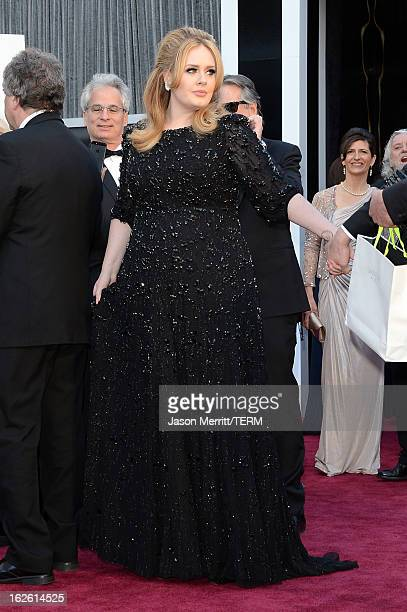 Singer Adele Adkins arrives at the Oscars at Hollywood & Highland Center on February 24, 2013 in Hollywood, California.