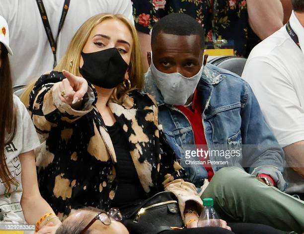 Singer Adele looks on next to Rich Paul during the first half in Game Five of the NBA Finals between the Milwaukee Bucks and the Phoenix Suns at...