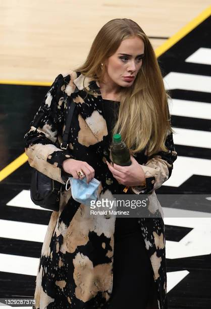 Singer Adele looks walks in during the second half in Game Five of the NBA Finals between the Milwaukee Bucks and the Phoenix Suns at Footprint...