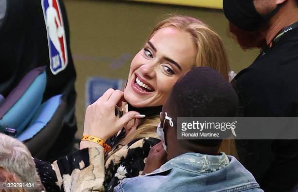 Singer Adele smiles with Rich Paul during the second half in Game Five of the NBA Finals between the Milwaukee Bucks and the Phoenix Suns at...