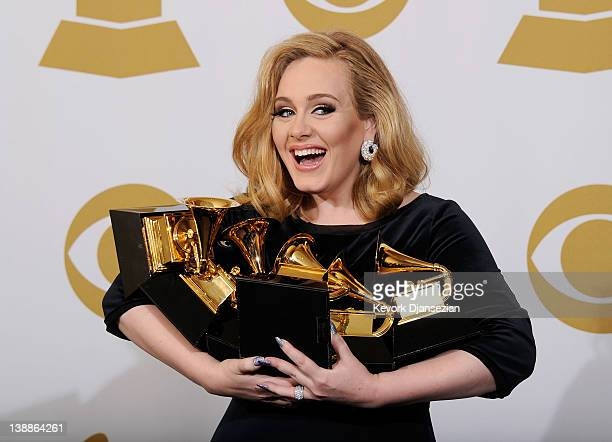 Singer Adele winner of six GRAMMYs poses in the press room at the 54th Annual GRAMMY Awards at Staples Center on February 12 2012 in Los Angeles...