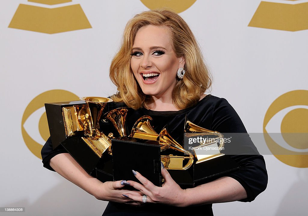 Singer Adele, winner of the GRAMMYs for Record of the Year for 'Rolling In The Deep', Album of the Year for '21', Song of the Year for 'Rolling In The Deep', Best Pop Solo Performance for 'Someone Like You', Best Pop Vocal Album for '21' and Best Short Form Music Video for 'Rolling In The Deep', poses in the press room at the 54th Annual GRAMMY Awards at Staples Center on February 12, 2012 in Los Angeles, California.