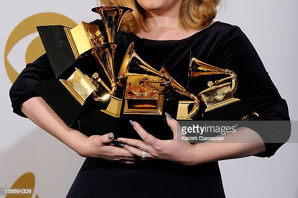 "Singer Adele, winner of the GRAMMYs for Record of the Year for ""Rolling In The Deep"", Album of the Year for ""21"", Song of the Year for ""Rolling In..."