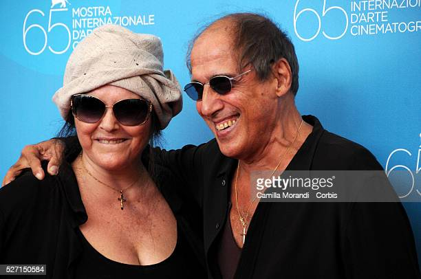 Singer Adriano Celentano and his wife Claudia Mori attend the photo call of Yuppi Du during 65th Venice Film Festival