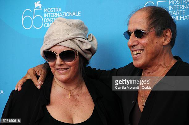 Singer Adriano Celentano and his wife Claudia Mori attend the photo call of Yuppi Du during 65th Venice Film Festival