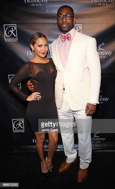 Singer Adrienne Bailon and NY Jets star Darrelle Revis attend the NFL Draft grand opening celebration at Rafaello & Co Jewelers on April 21, 2010 in...