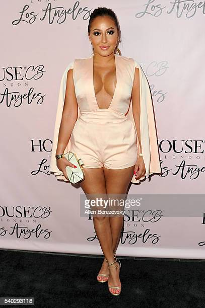 Singer Adrienne Bailon attends the House of CB Flagship Store Launch party at the House of CB on June 14 2016 in West Hollywood California