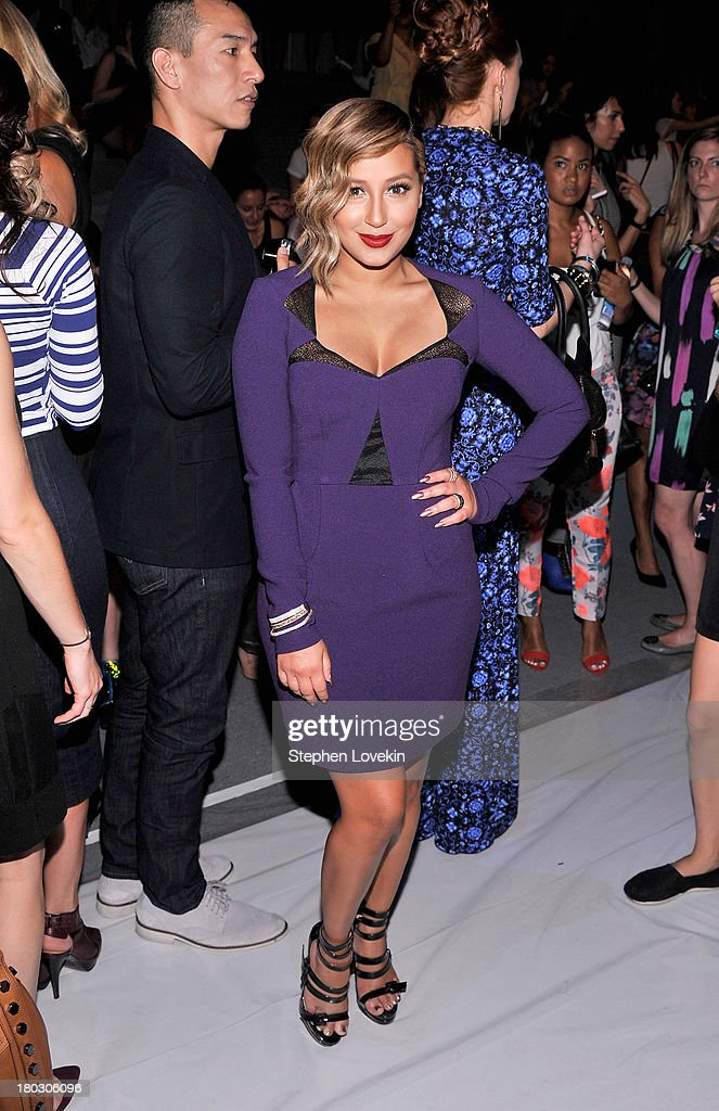 Singer Adrienne Bailon attends the Nanette Lepore fashion show during Mercedes-Benz Fashion Week Spring 2014 at The Stage at Lincoln Center on September 11, 2013 in New York City.
