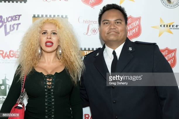 Singer Afida Turner and Anthony Begonia with the Salvation Army attends The Salvation Army Celebrity Kettle Kickoff Red Kettle Hollywood at the...