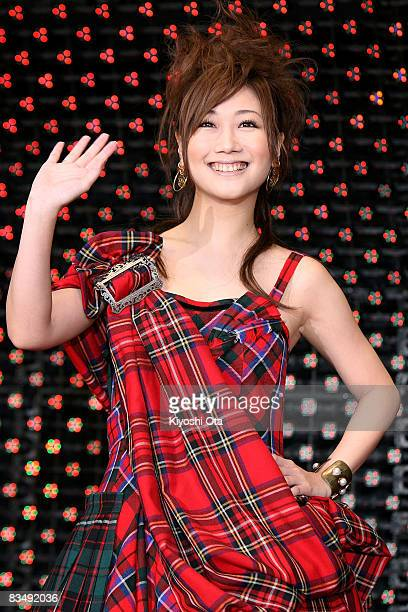 Singer Ai Otsuka waves to fans upon her arrival for 'Red Cliff Part 1' PreOpening Gala at Roppongi Hills on October 30 2008 in Tokyo Japan The film...