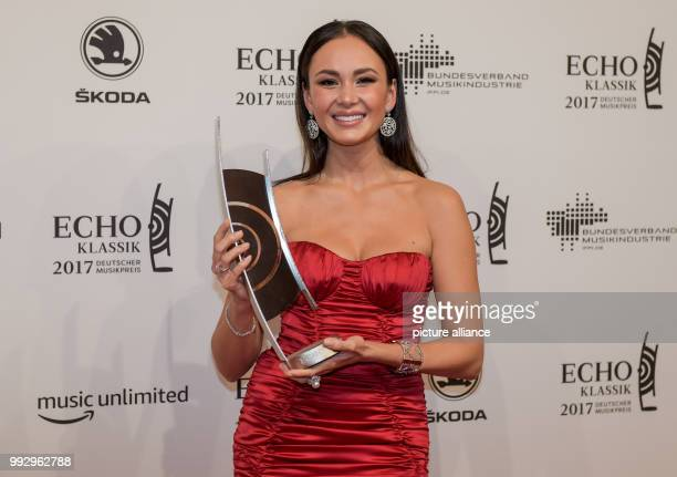 Singer Aida Garifullina shows her award in the category 'soloistic recording' at the 'EchoKlassik' classical music award ceremony in Hamburg Germany...