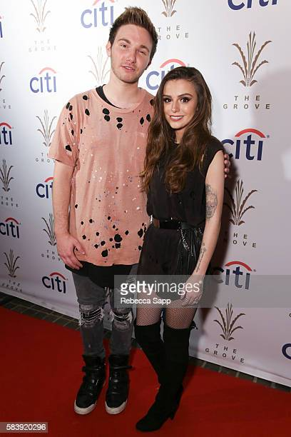 Singer AJ and singersongwriter Cher Lloyd pose for portait backstage at Citi Presents Cher Lloyd at the Grove's 2016 Summer Concert Series at The...
