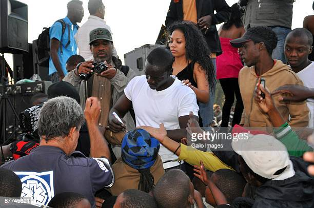 US RB singer Akon surprised locals when he shot scenes for his new music video in Soweto He was greeted by fans when he arrived to film sequences for...