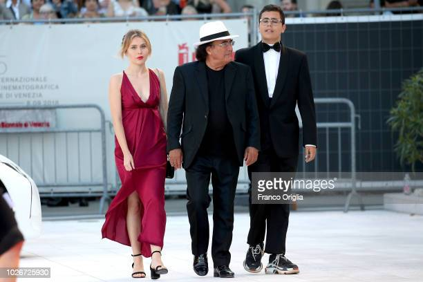 VENICE ITALY SEPTEMBER Singer Al Bano his daughter Jasmine Carrisi and his son AlBano Carrisi Jr walk the red carpet ahead of the 'Vox Lux' screening...