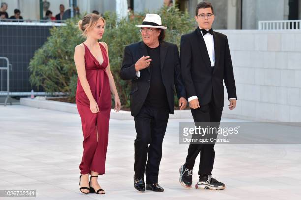 Singer Al Bano his daughter Jasmine Carrisi and his son AlBano Carrisi Jr walk the red carpet ahead of the 'Vox Lux' screening during the 75th Venice...