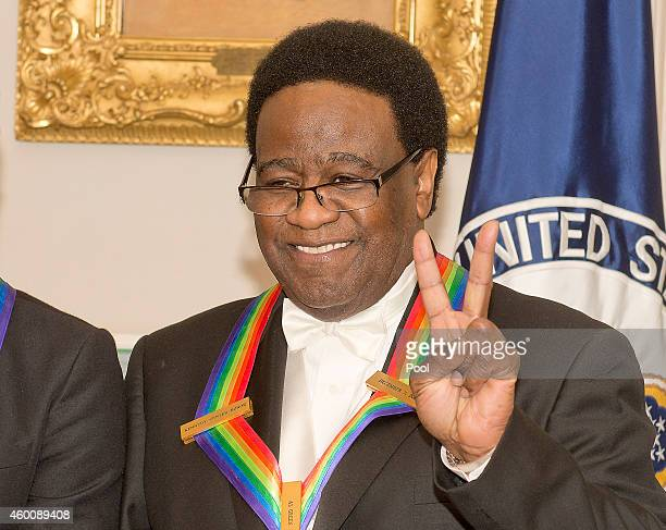 Singer Al Green, one of the five recipients of the 2014 Kennedy Center Honors, waits to pose for a group photo following a dinner hosted by United...