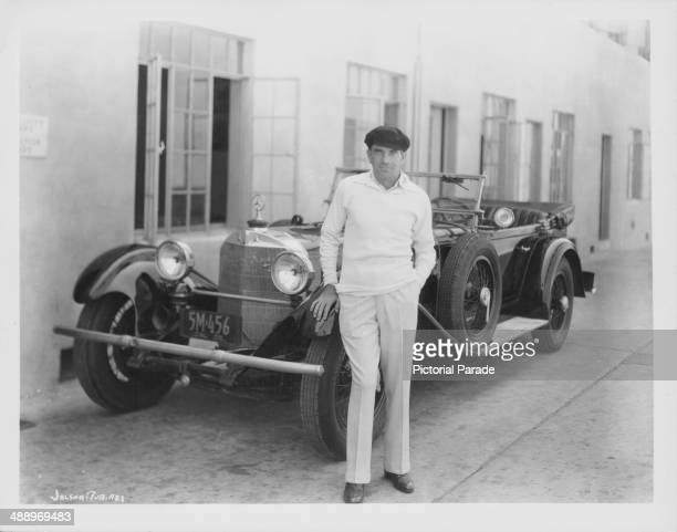 Singer Al Jolson standing on the Warner Bros Studio lot next to his Mercedes Benz Los Angeles California 1929