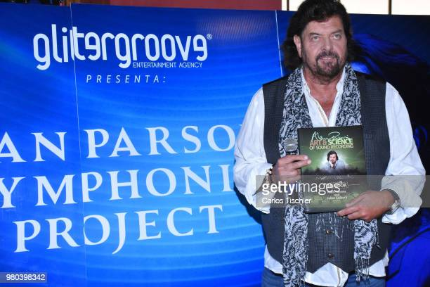 Singer Alan Parsons poses for photos with his book 'Arts and Science of Song Recording' during the press conference to announce the Symphonic Concert...