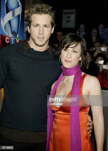 Singer Alanis Morissette and boyfriend actor Ryan Reynolds arrive at the 2004 Juno Awards at the Rexall Place April 4 2004 in Edmonton Alberta Canada...