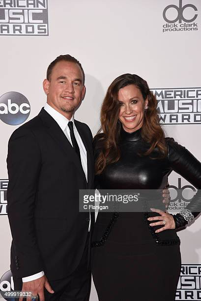 Singer Alanis Morissette and husband Mario Treadway arrive at the 2015 American Music Awards at Microsoft Theater on November 22 2015 in Los Angeles...