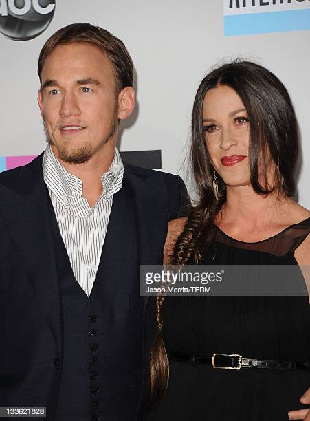 "Singer Alanis Morissette and Mario ""MC Souleye"" Treadway arrive at the 2011 American Music Awards held at Nokia Theatre LA LIVE on November 20 2011..."