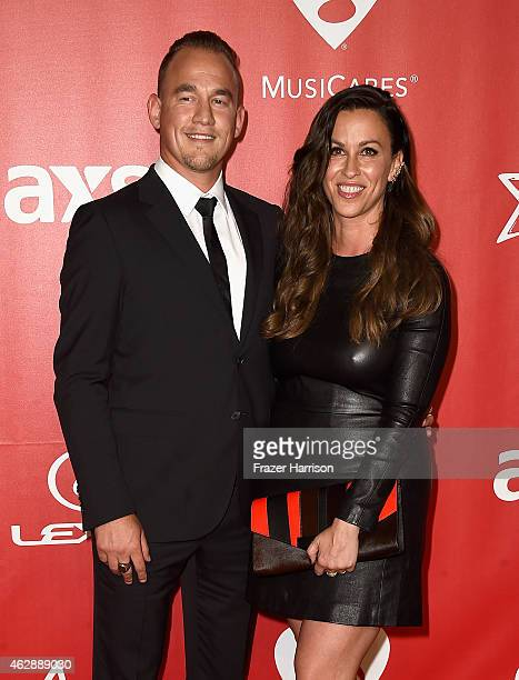 Singer Alanis Morissette and Mario Treadway attend the 25th anniversary MusiCares 2015 Person Of The Year Gala honoring Bob Dylan at the Los Angeles...