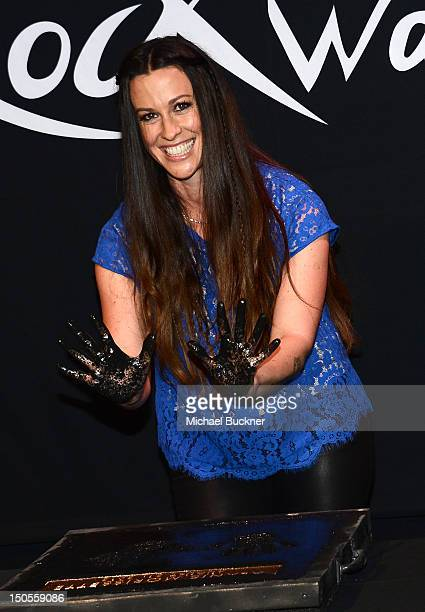 Singer Alanis Morissette is honored with handprints on Guitar Center's Rockwalk at Guitar Center on August 21 2012 in Hollywood California