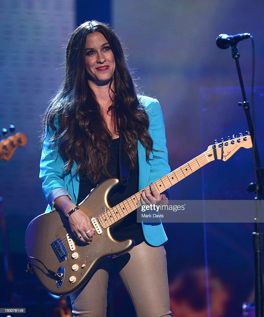 Singer Alanis Morissette performs at the MDA Show of Strength held at CBS Television City on August 9, 2012 in Los Angeles, California. The show airs on Sunday, September 2, 2012 at 8PM