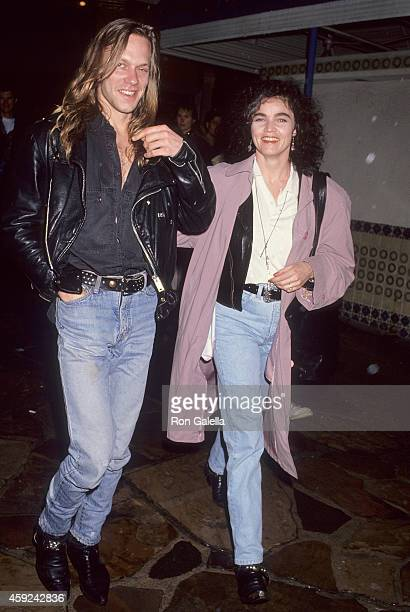 Singer Alannah Myles and date attend the Wayne's World Westwood Premiere on February 6 1992 at the Mann Village Theatre in Westwood California