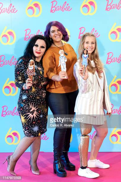 Singer Alaska scientist Nerea Luis and paralimpic athlete Desiree Vila attend a photocall to celebrate the 60th anniversary of Barbie at Allard Club...