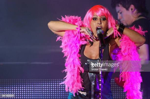 """Singer Alejandra Guzman performs onstage during the launch of her new album """"Unico"""" at Salon Vive Cuervo on December 8, 2009 in Mexico City, Mexico."""