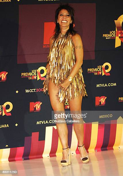 Singer Alejandra Guzman shows her leg autographed by Flava Flav in the press room during the 7th Annual 'Los Premios MTV Latin America 2008' Awards...