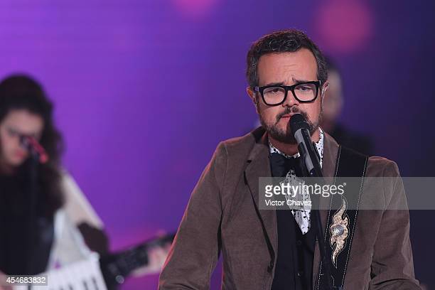 Singer Aleks Syntek performs on the runway during the Liverpool Fashion Fest Autumn/Winter 2014 fashion show at Hipodromo De Las Americas on...